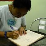 每日放工,黃女士就去社區輔導中心接兒子,還會幫他整理功課輔導的筆記。